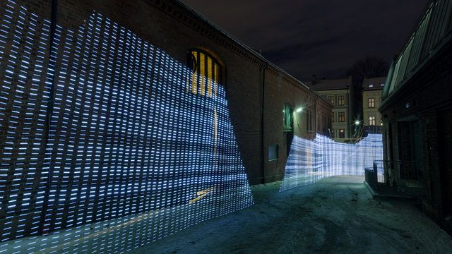 Immaterials: Light painting WiFi by Timo. This project explores the invisible terrain of WiFi networks in urban spaces by light painting signal strength in long-exposure photographs.
