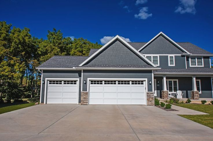 CHI Model 2294 Recessed Panel Garage Doors in White.