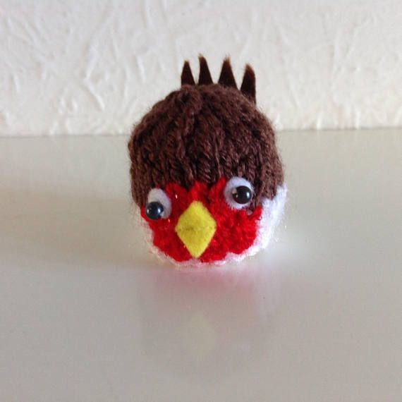 This is a cute hand knitted robin to cover a Ferrero Rocher chocolate or similar. Not just for Christmas but any occasion. Ideal for a twitchers birthday/party! Made from Acrylic yarn, felt and beads. Please do not give to a child under 3years of age due to small parts.
