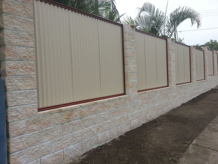 Block Wall Design Ideas : Elegant white cement block fence wall that decorated with