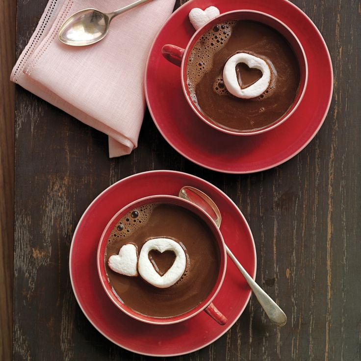 """Nothing says """"I love you"""" like a warm mug of chocolate with floating marshmallow hearts."""