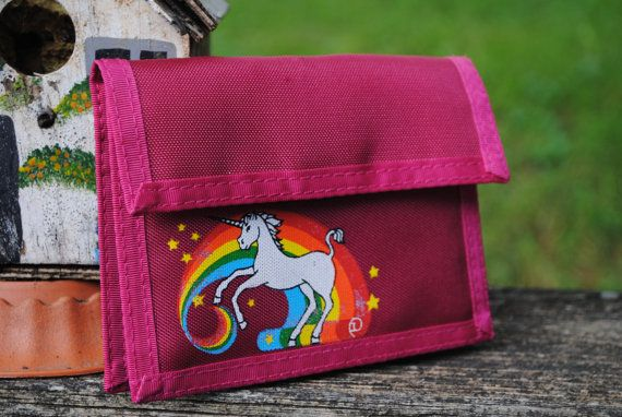 Velcro wallet.  I always get excited when I see the exact same style/design of something I owned as a child.  Had this! #80s #unicorns