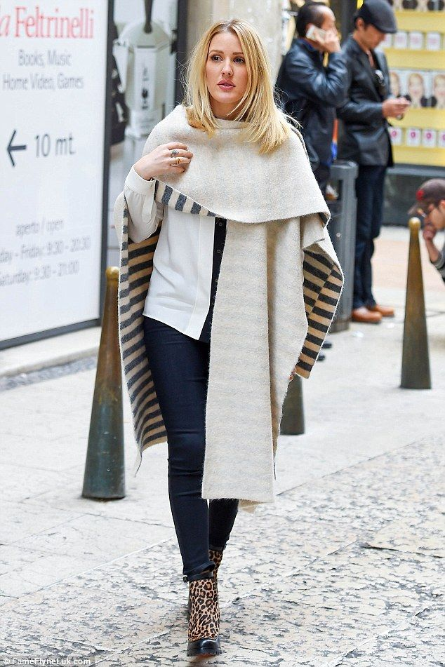 Splashing out:Ellie Goulding looked as on-trend in a striped wrap and leopard print boots as she went shopping in Verona, Italy, on Saturday