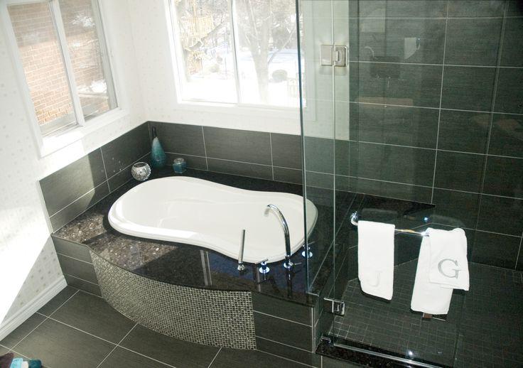 Dark 12 X 24 Porcelain Tiles On Bathtub Backsplash Skirt Shower Walls Dark Brown Granite Along Bathtub Deck And Shower Stepup Looks Fabulous