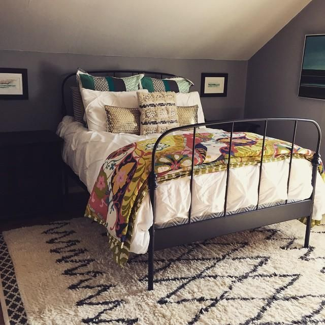 Wonderful A Cozy Attic Bedroom With An Old Iron Bed Frame.