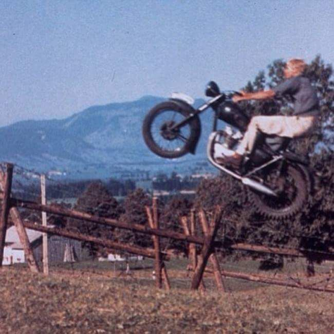 American Triumph dealer Bud Ekins doing the 65ft. motorcycle jump in the 1963 film 'The Great Escape'. He did this jump in one take, not Steve McQueen.
