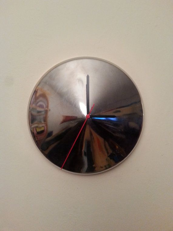 This is extraordinery piece of car art!  It is wall clock made from Tatra 603, socialistic oldtimer produced in communistic Czechoslovakia in