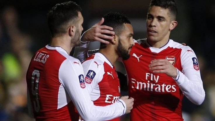 Theo Walcott scores his 100th goal for Arsenal as he doubles the Gunners' lead in their FA Cup fifth-round tie against non-league Sutton United at Gander Green Lane.