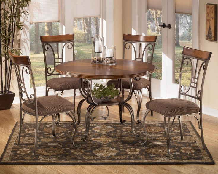 Plentywood Round Table 4 UPH Side Chairs By Signature Design Ashley Get Your At Factory Direct Furniture