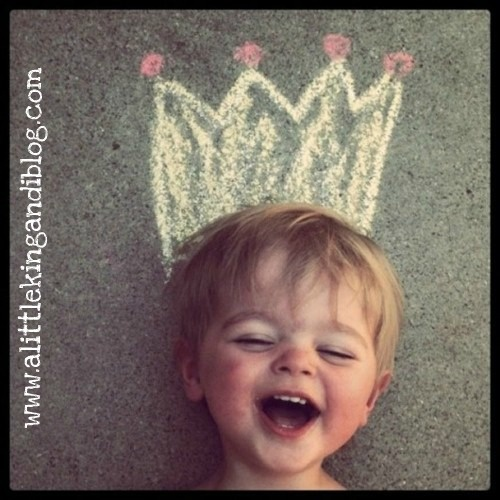 Grab some chalk and draw crowns, antlers - any silly hats their hearts desire, then have the little ones pose!