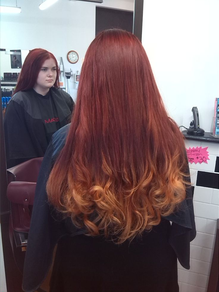 Red and copper balayage or ombre, with some curls for this long hair.