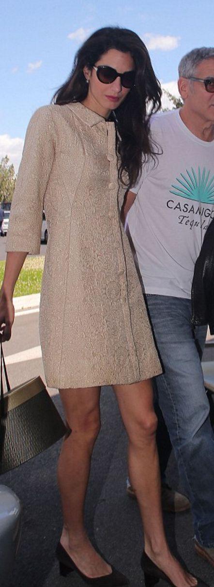 Amal Clooney: Coat – William vintage Balenciaga  Sunglasses – Salvatore Ferragamo  Shoes – Sarah Flint