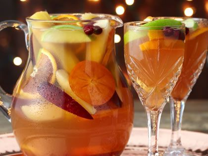 Simply Holiday Sangria Recipe - A pitcher of Holiday Sangria will add instant cheer to your holiday table this year. Make your own with this easy sangria recipe.