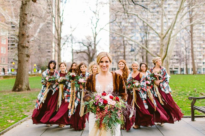 Burgundy bridesmaid dresses and plaid shawls are picture perfect for a Christmas wedding.