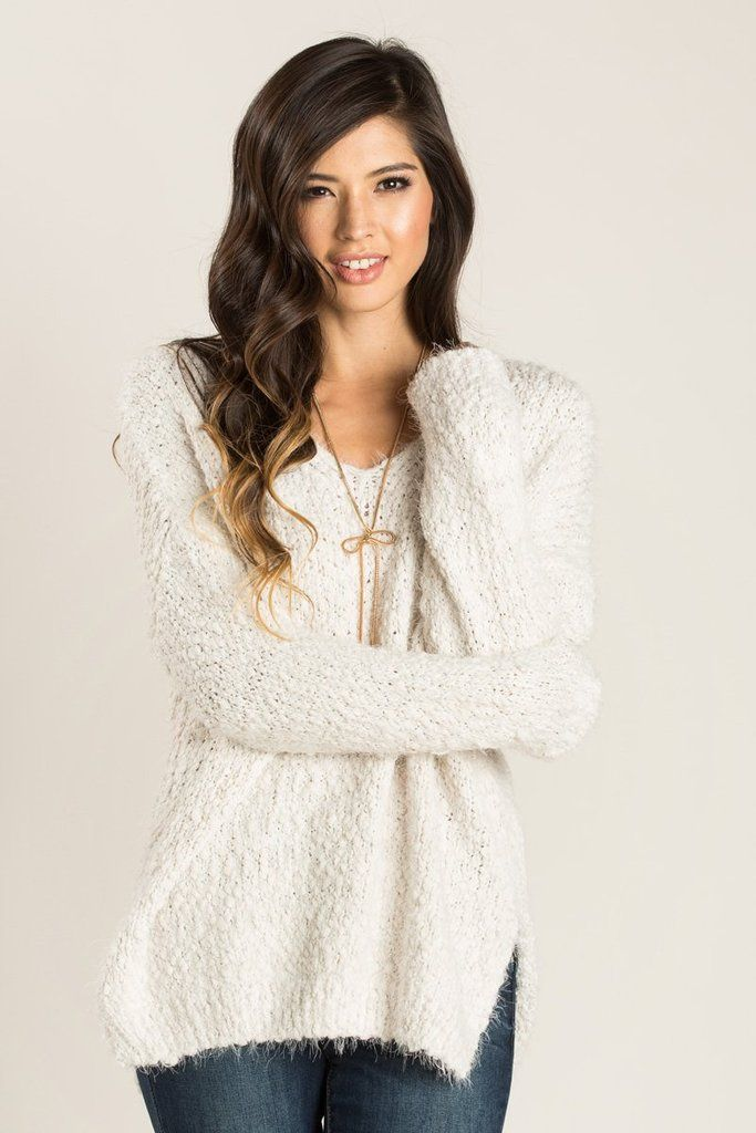 e4f0bcf72c683 We love this super soft and cozy v-neck sweater! The eyelash popcorn knit  and classic ivory color make this a.