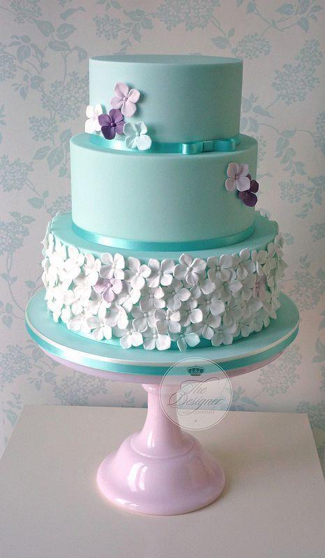 Hydrangeas on a tiffany blue three-tiered wedding cake #wedding #weddingcake #cake #tiffanyblue #flowers