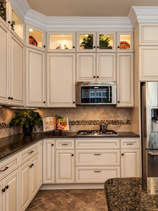 love this color scheme. Tropical brown granite, with creme cabinets ...