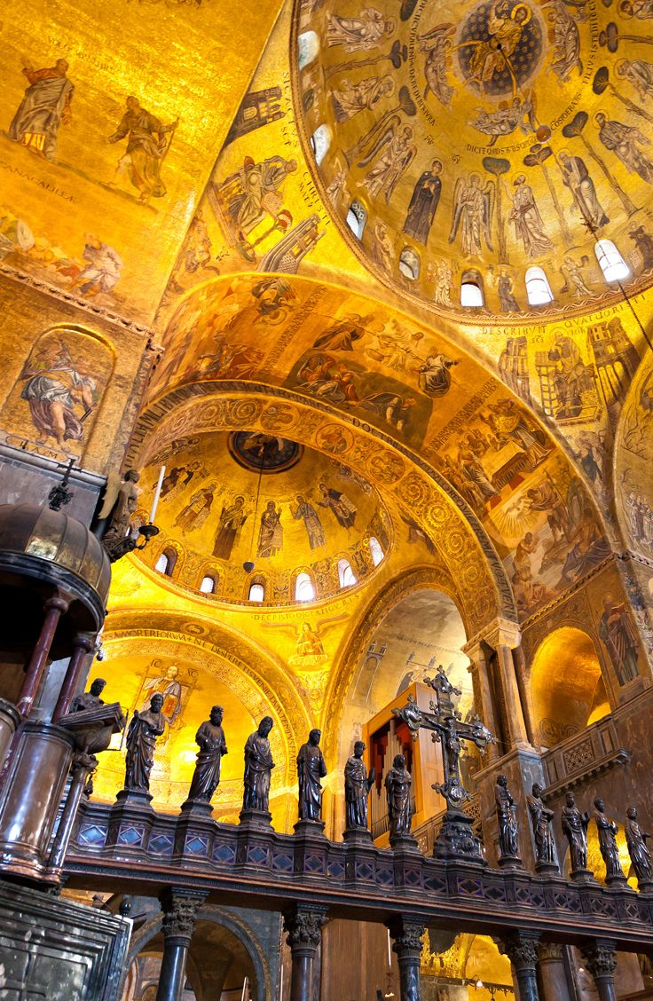 Visit the shimmering, mosaic-filled St. Mark's Basilica in Venice.