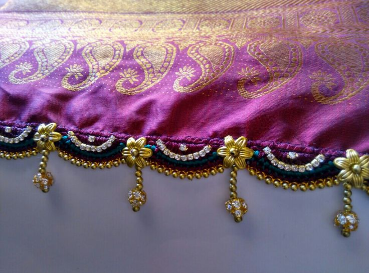 Adding shine to saree