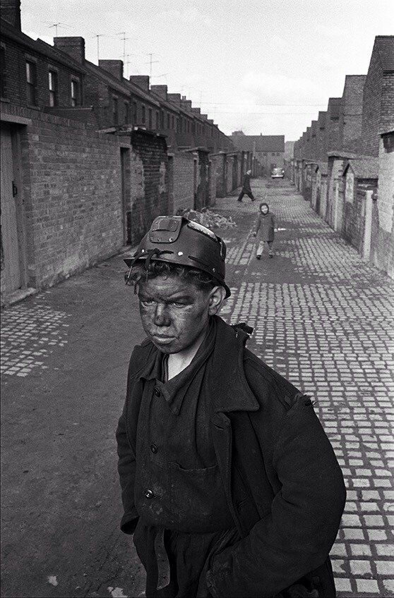A young miner returns home from his shift at the Horden coal mine, County Durham, 1960s.