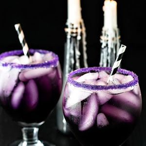 Purple People Eater Cocktail With Sugar, Vodka, Blue Curaçao, Sweet And Sour Mix, Grenadine, Cranberry Juice