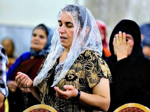 """Displaced Christians in Mosul AP """"One of the women looked up and seemed to be almost smiling as she said, 'Jesus!'"""" just before being be-headed."""