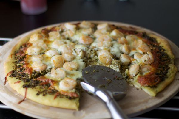 Shrimp and Pesto Pizza - twist to traditional pizza. I usually order the exact same pizza anywhere we go: whatever the meatiest option is. And it always has red sauce. Pasan likes to experiment with different p