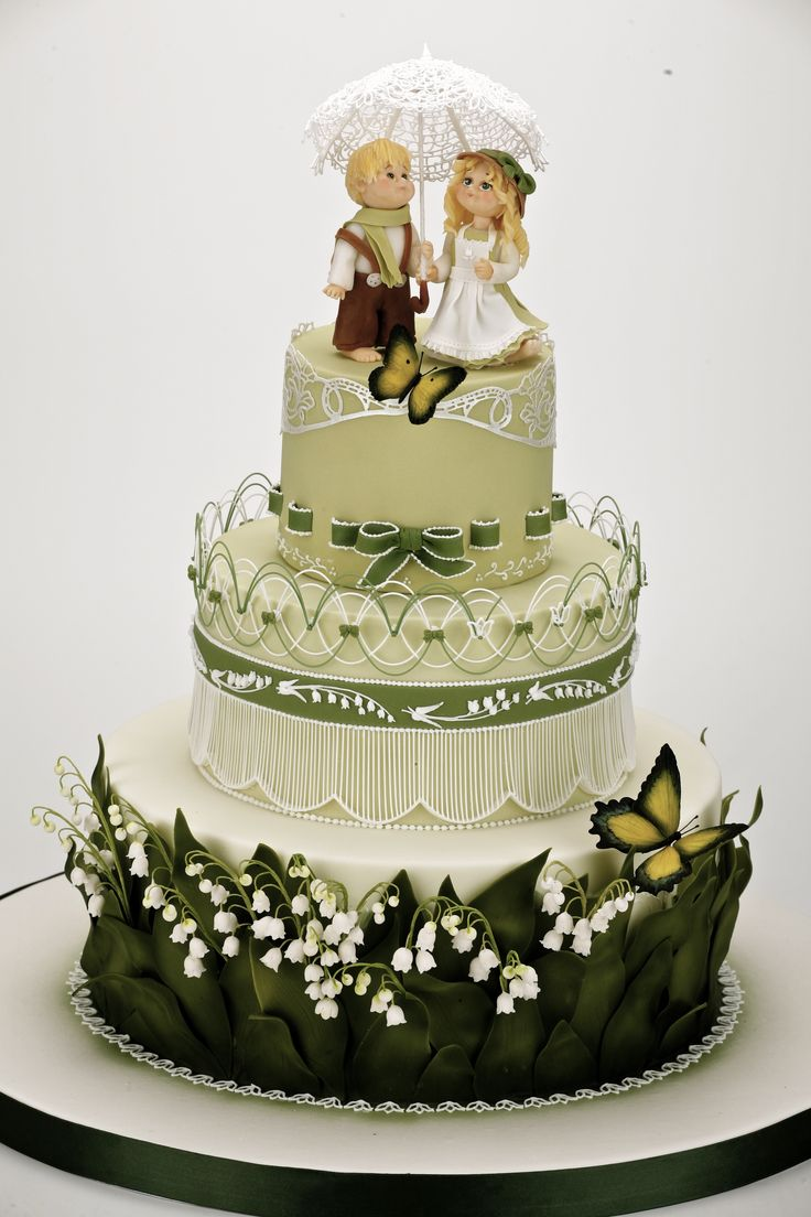 Lily of valley spring wedding cake. Ok. Los novios no son el fuerte del artista, pero las tecnicas que usó, son de un dotado. Parece de Tobba Garret.