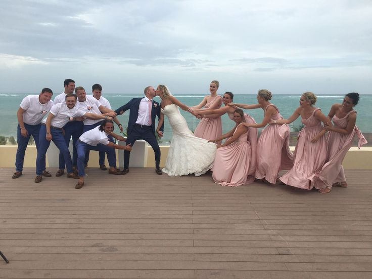 Beach wedding bridesmaids and groomsmen pictures Royalton riviera Cancun Sky wedding Eliza and Ethan and Allure wedding dress