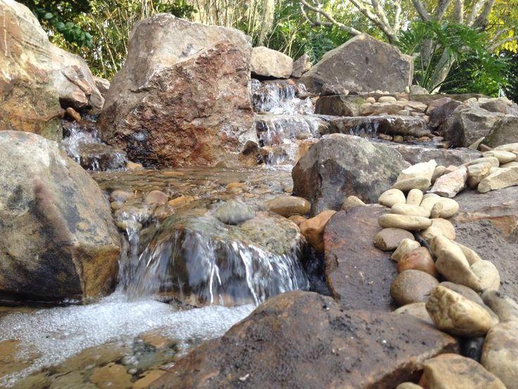 Waterfall Created By Living Waters Landscape Service In Battle Creek, MI.