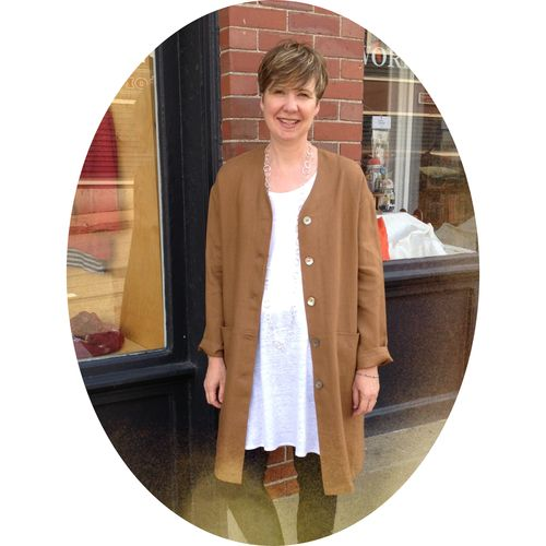 Linen unlined and collarless long sleeved coat. Available in tobacco, grey and red. By Terra Cotta, $160.   Classic and simply elegant, this coat looks great over a pair of Yoga Jeans or even leggings. Wear it to work, or when you're out for an evening stroll.