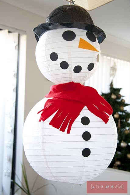 White paper lanterns can be decorated to make snowmen quickly and easily for your children's bedrooms