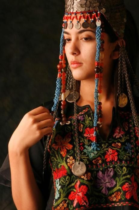 Portrait of a Palestinian woman, wearing traditional adornment | Just one of the many images that was on display at the Palestinian Estate Exhibition in Johannesburg, 2009, where emphasis was placed on the embroidery and jewellery from the different regions of Palestine.
