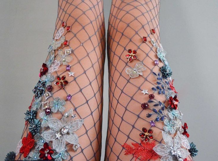 http://www.revelist.com/style-news/sparkly-tights/6858/NYC-based artist Lirika Matoshi hand-creates the most AMAZING embellished fishnet tights./1/#/1