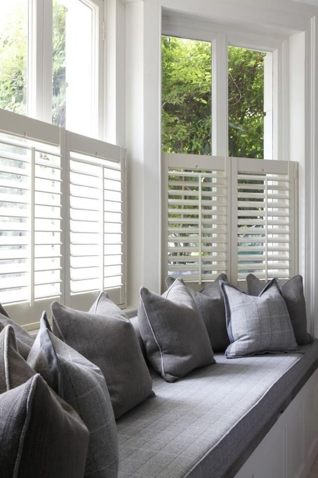 Simple greys with cafe style white shutters scream colonial charm at its best.