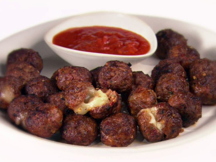 Meatballs a la Pizzaiola from FoodNetwork.com.  These are awesome....just reduce the crushed red pepper if you do not want them too spicy!