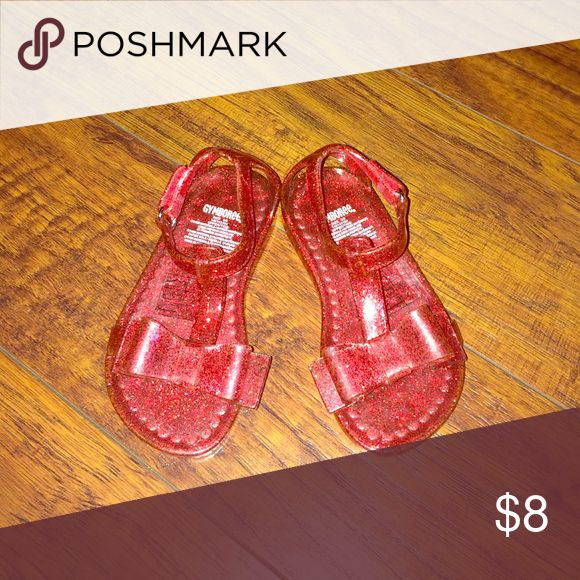 Ruby red bow jellies Red glitter jelly sandals with bows on top. Great condition, worn twice. Size 5/6            15gy July refsh Gymboree Shoes Sandals & Flip Flops