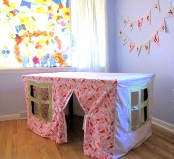 Table and a sheet made to look like a play house for a hut!