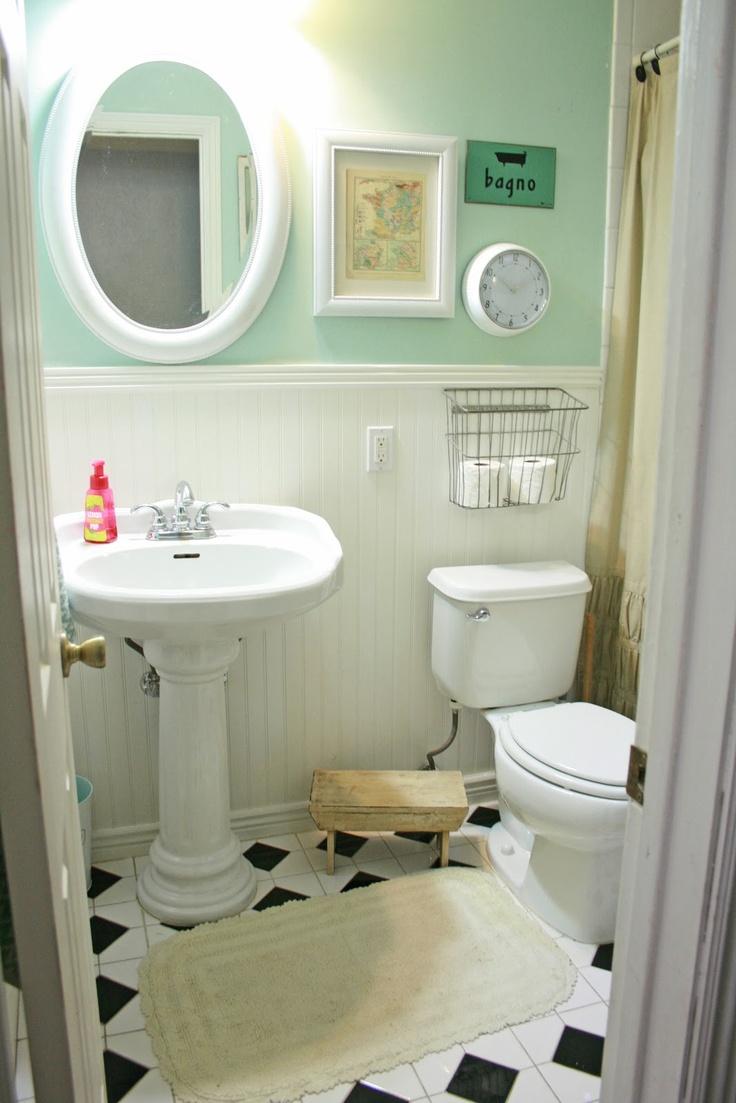 Small bath. Love the toilet paper storage basket