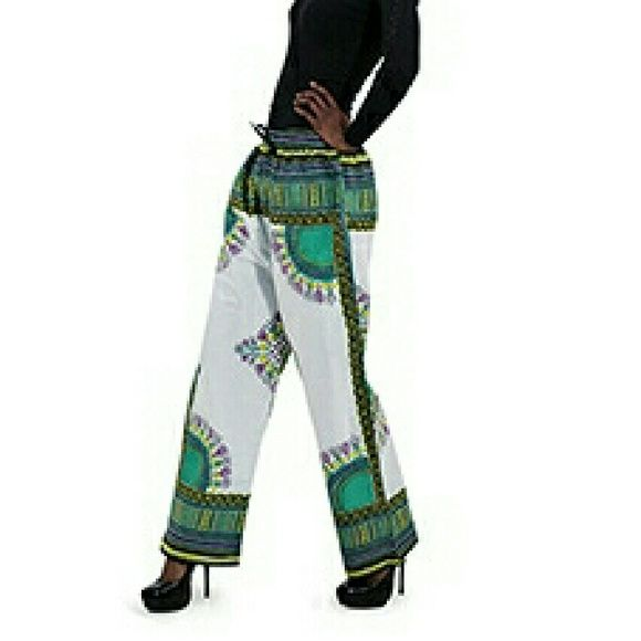 African Print Pants African Print Pants have a drawstring in the waist. Fits most up to 38 inch waist ,26 inch inseam and 40 inch length. Pants