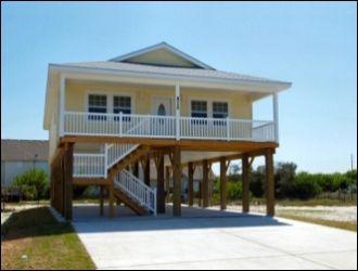 Custom built coastal stilt house single family new home for Stilt house plans florida