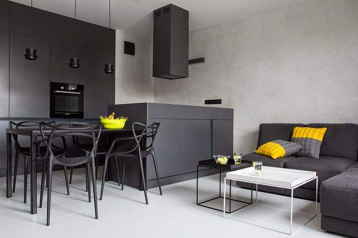 Jurnal de design interior: Alb, negru și galben într-un apartament minimalist