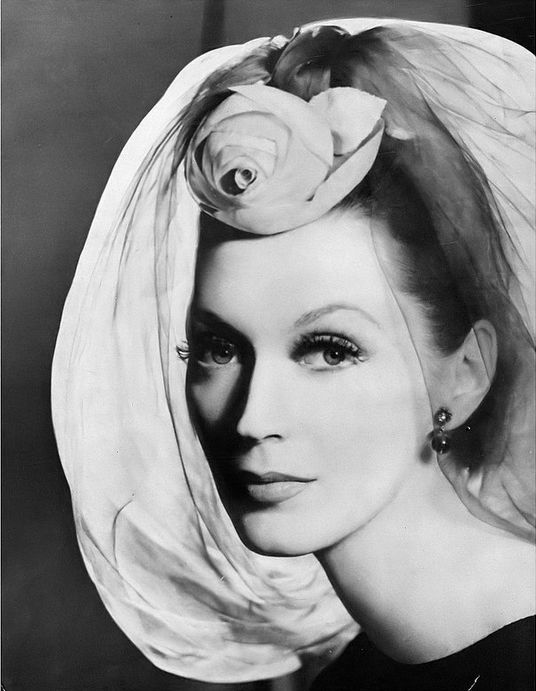 1958 Pierre Cardin evening hat of silk gauze in a pale mauve with a blue rose set at the forehead, worn by Dovima, photo by Richard Avedon, Harper's Bazaar