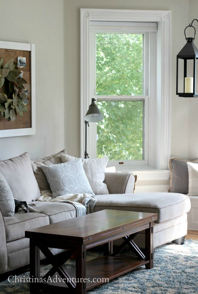 Cozy fall family room with touches of blue - love this old house character with a window seat, sectional and neutral home decor with light blue accents