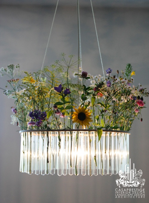 This unusual glass tube chandelier illuminates your home while shedding a little light on your own unique sense of style. These suspended ceiling fixture features a central light bulb surrounded by a single or double row of glass test tubes - which is in and of itself an experiment in style! When empty, the glass sparkles like dazzling icicles in the light, or line the tubes with flowers to create an overhead bouquet, bringing some spring and summer into your home in any season.