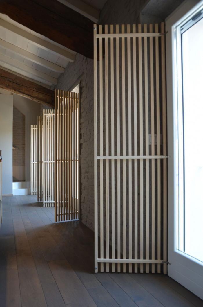 Wood strip doors in studio apartment in hallway in Italy