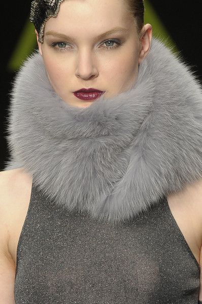 """Chic dyed fur collar beautifully frames the polished face.  Pale eyes with dark crimson lips says,""""She has the look!"""""""