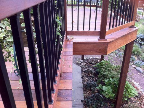 In this project, we refurbished an existin pressure-treated wood deck by replacing the decking and railing with ipe hardwood. This deck features a gate and flared steps.
