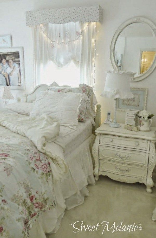 Shabby Chic Bedroom With Fairy Lights Over Headboard And Whitewashed Nightstand