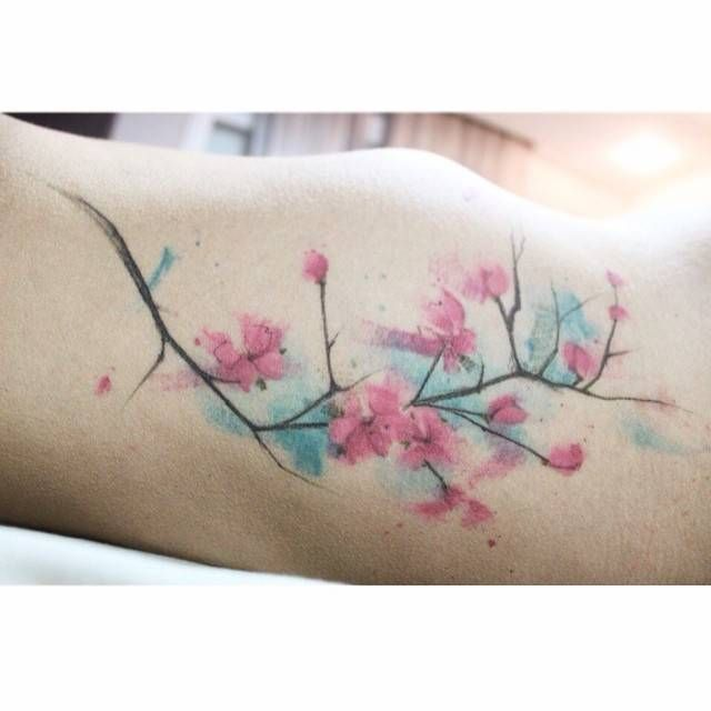 Watercolor style cherry blossoms on the ribs. Done by ...